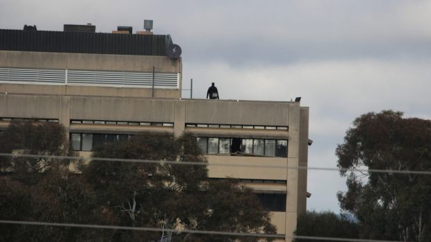 A police officer on the roof of the vacant former CSIRO headquarters in Campbell in May 2017 after reports of trespassing.