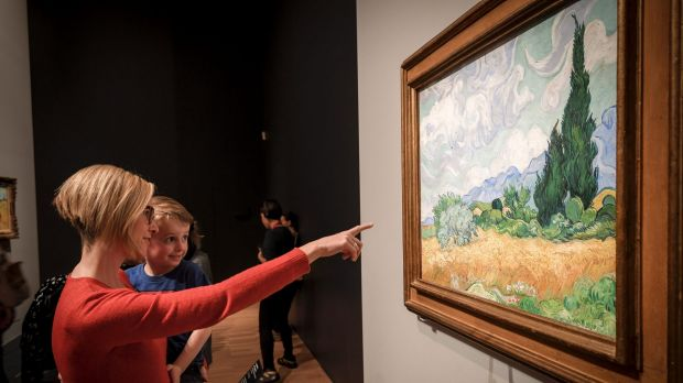 Jennifer Maxwell, pictured with her son Levi, 4, was the 150,000th visitor to Van Gogh and the Seasons at NGV International.