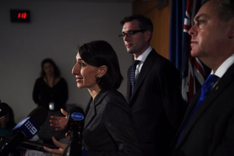 Premier Gladys Berejiklian, Treasurer Dominic Perrottet and Housing and Planning Minister Anthony Roberts announcing a ...