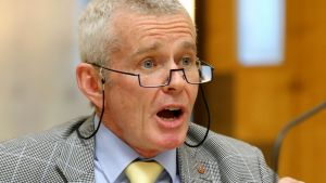 One Nation Senator Malcolm Roberts puts questions to Chief Scientist Dr Alan Finkel during a Senate Estimates hearing at ...