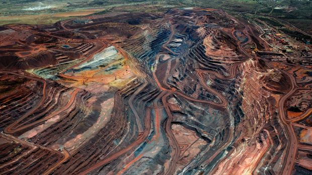 Oil, copper weigh on BHP's iron ore growth
