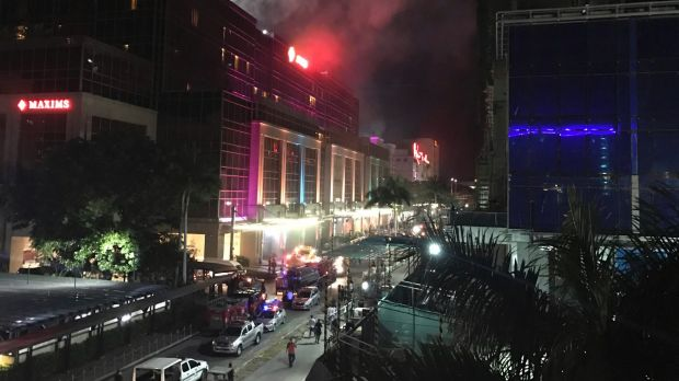 Gunshots and explosions rang out early Friday at a mall, casino and hotel complex near Manila's international airport in ...