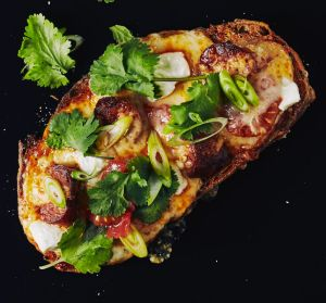 Cheese on toast with chorizo.