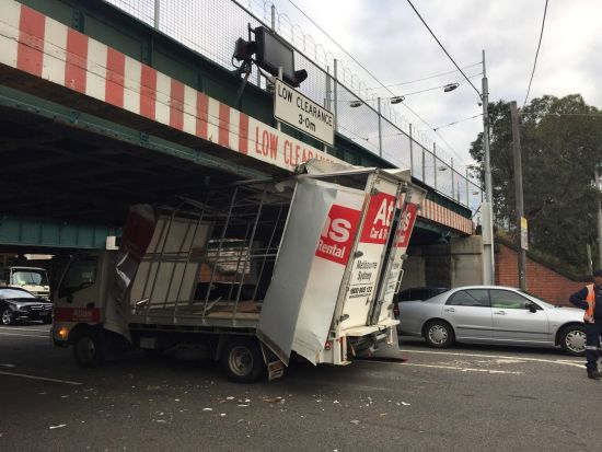 A rental truck negotiates the Montague Street bridge on Friday afternoon.