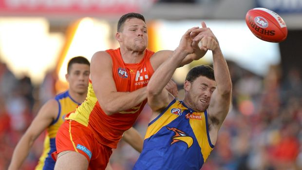 The Suns' Steven May challenges West Coast's Jeremy McGovern.