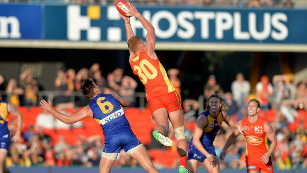 Gold Coast's Peter Wright takes a mark before going on to kick the winning goal.