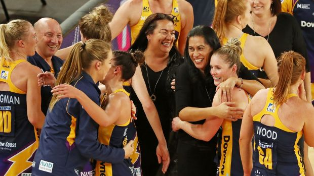 Sunshine Coast Lightning coach Noeline Taurua and her players celebrate after winning the Super Netball major semi-final ...