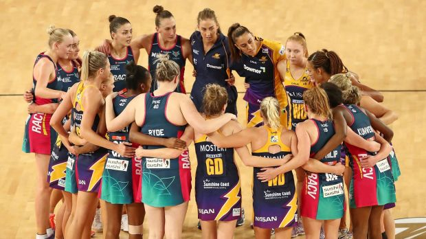Lightning and Vixens players form a huddle after the Super Netball major semi-final.