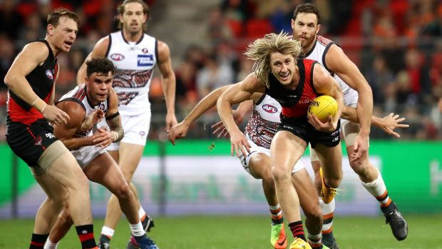 Essendon's Dyson Heppell makes a break for it.