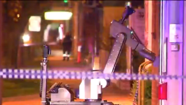 A bomb disposal robot at Main Street, Pakenham in front of the National Australia Bank.