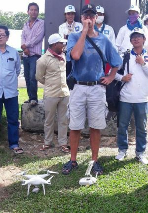 James Ricketson with a drone and its remote control device in a picture from the Cambodian website.