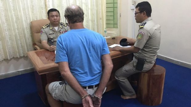Cambodian police have questioned James Ricketson, seen here in handcuffs, over his use of a drone in the capital Phnom ...
