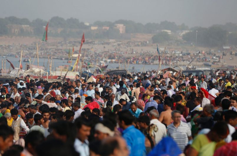 Indian Hindu devotees gather to take holy dips at Sangam, the confluence of the Rivers Ganges, Yamuna and mythical ...