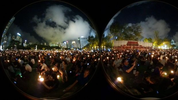 Demonstrators attend a candlelight vigil at Victoria Park in Hong Kong, China.
