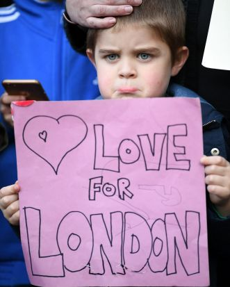 James Little, 5, holds up a message for the victims of the London terrorist attacks at the County Hotel  in Carlisle, ...