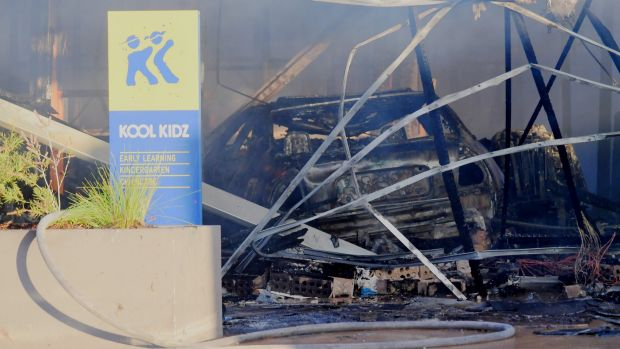 A car has ploughed into a childcare centre in Tarneit, destroying the building and killing the driver.