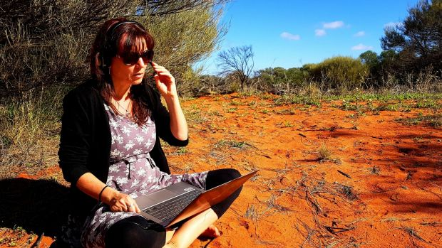 Lia Hills recording voice and sounds for her story on the road.