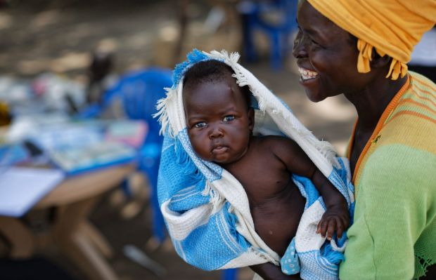 South Sudanese refugee Betty Sakala, from Central Equatoria state, laughs after being shown a photo of her daughter ...