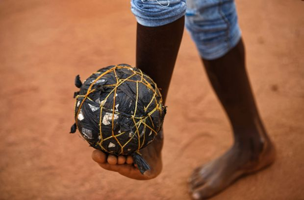 A South Sudanese refugee boy plays with a ball made from plastic bags and string, on the day that much of the world ...