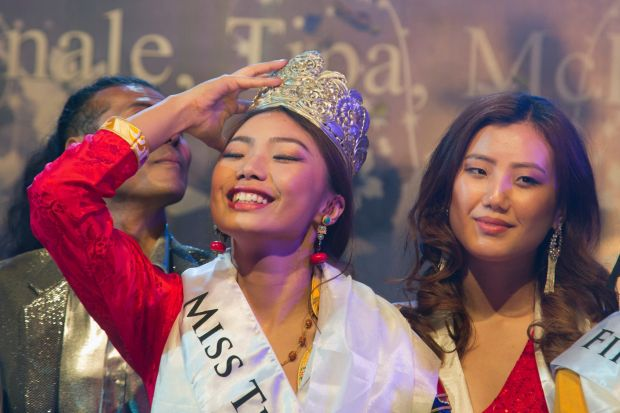 Tenzin Paldon, 21, reacts after winning the 2017 Miss Tibet beauty pageant at the Tibetan Institute of Performing Arts ...