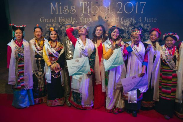 Tenzin Paldon, 21, center, reacts after winning the 2017 Miss Tibet beauty pageant at the Tibetan Institute of ...