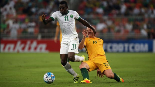 Saudi midfielder Abdulmalek Al-Khaibri breaks free of Socceroo Aaron Mooy in the Jeddah qualilfying leg in October.