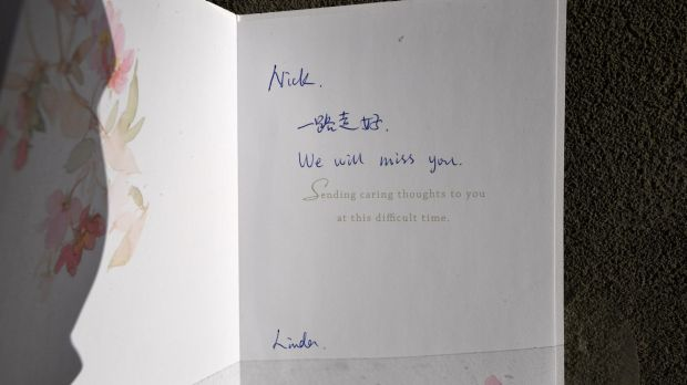 A card for the Brighton terror victim left outside the apartment block where he was killed.