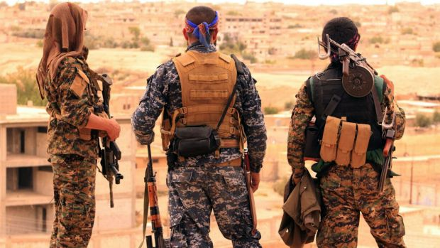 Syrian Democratic Forces fighters near the northern Syrian town of Tabqa.
