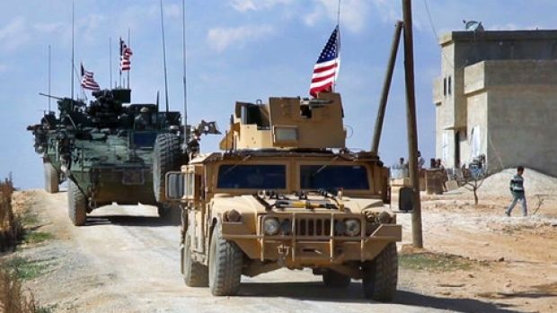 US forces patrolling on the outskirts of the Syrian town of Manbij.