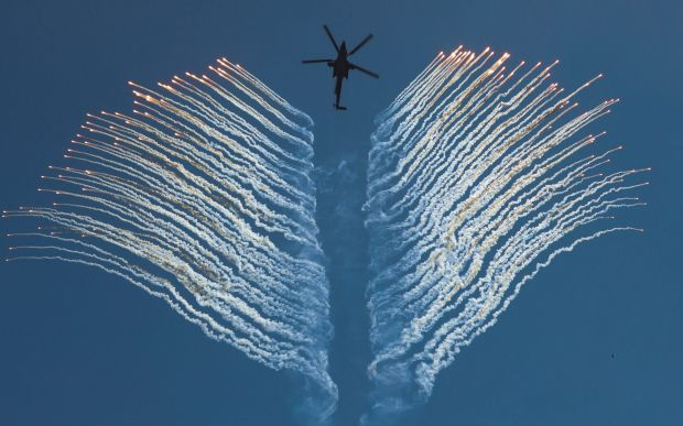A Russian Army's MI-28N helicopter of aerobatic team Berkuts (Golden Eagles) performs during an air show marking 75th ...