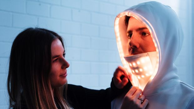 Textile designer Lillian Hambling with a friend modelling her wearable technology garment, e-motion, to create a new ...
