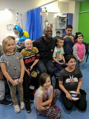 Seal visiting the Sydney Children's Hospital this week where he caught up with Canberra girl Freyja Christiansen (right ...