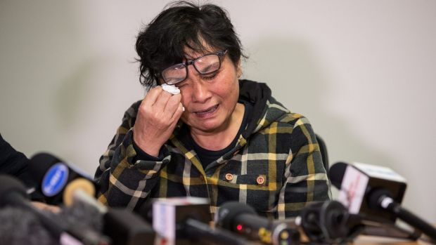 The mother of terror victim Nick Hao fights back tears as she remembers her son.