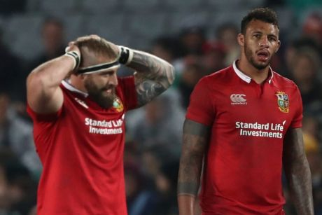 Red alert: Courtney Lawes of the British and Irish Lions and teammates come to terms with defeat against the Blues at ...