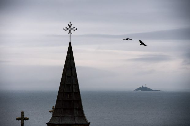 Birds fly past a church steeple in St Ives, UK, before the election.