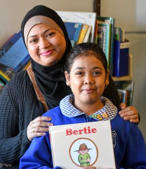 Parent Sabrina Ahmed with her daughter, Nuhad, 8, during a reading group at Belmore South Public School in Sydney.