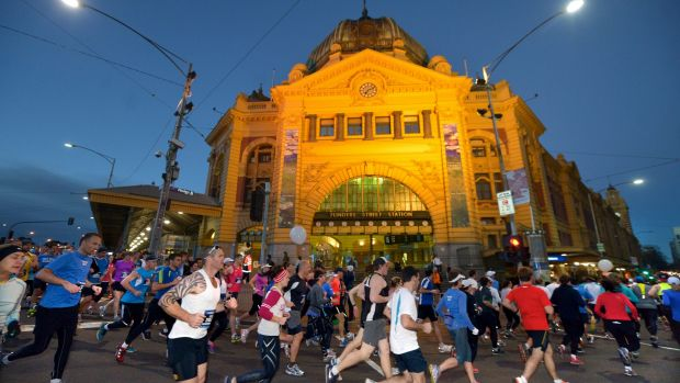 Thousands of runners make their way around the circuit of The Age Run Melbourne.