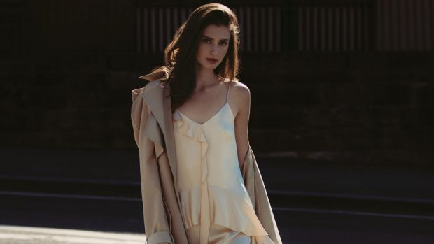 "Dion Lee trench coat, $2490. Jonathan Simkhai ""Ruffle-Trimmed"" silk-satin dress, $1398, from Matches Fashion."