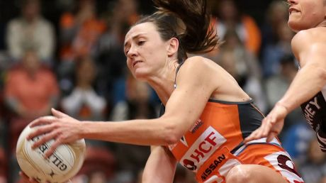 Back in orange: Bec Bulley of the Giants wins the ball under pressure from Shae Brown of the Magpies during the Super ...