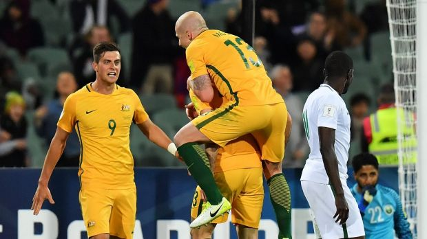 Socceroos Tomi Juric, Aaron Mooy and Tomas Rogic a celebrate after scoring a goal against Saudi Arabia earlier this month.