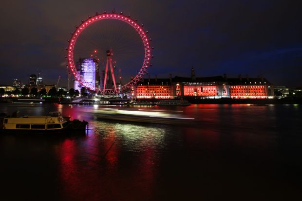 The London Eye is illuminated in red, the colour of the Labour Party, after the first exit polls of Britain's general ...