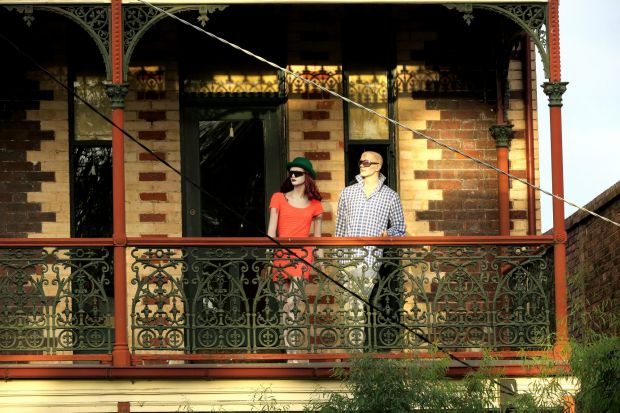 Two well-dressed silent witnesses observe the world from a Victorian balcony in Middle Park.
