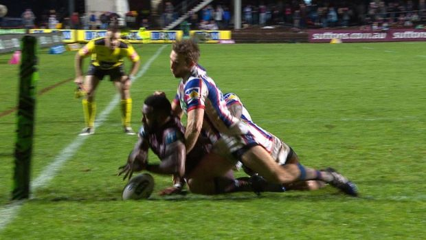 Controversy: Akuila Uate drops the ball over the line, but the try was awarded.