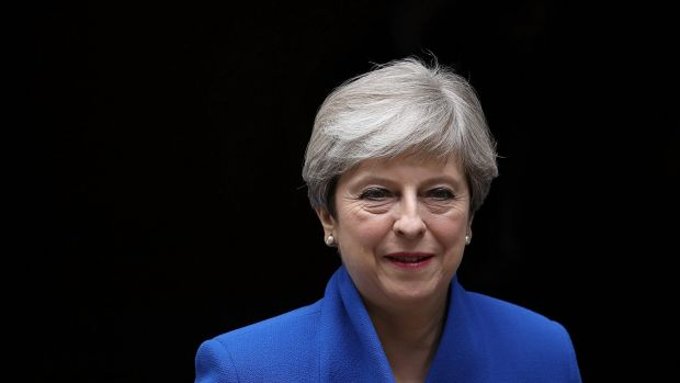UK Prime Minister Theresa May says she'll stick to Brexit timetable
