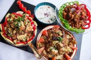 The dates are followed by light soups and salads. These salads, of fried cauliflower and zuchinni, are accompanied with ...