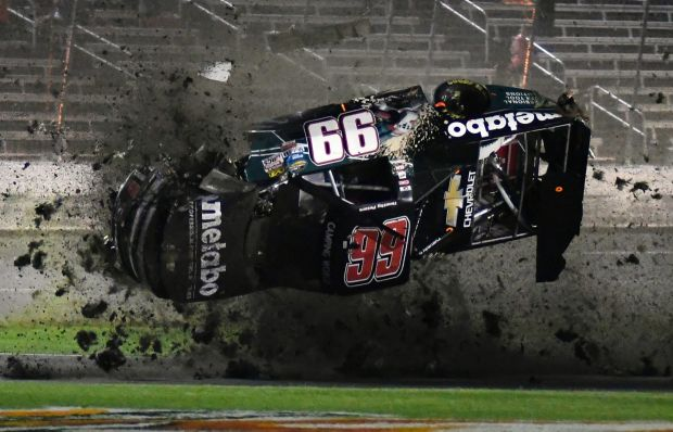 Timothy Peters flips coming down the front stretch during the NASCAR Trucks auto race at Texas Motor Speedway, Friday, ...