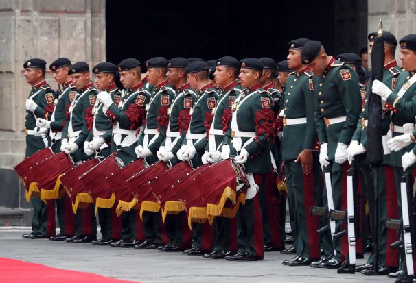 An Honor guard prepares for the arrival of German Chancellor Angela Merkel at the National Palace in Mexico City, ...