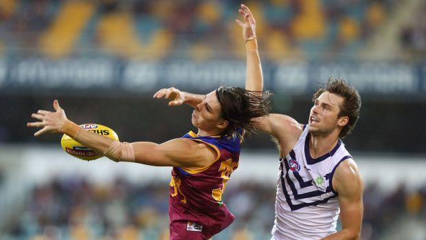 The Lions' Eric Hipwood competes with Fremantle's Joel Hamling.