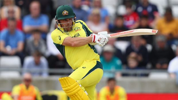 Aaron Finch adds to his 96-run stand with Steve Smith.