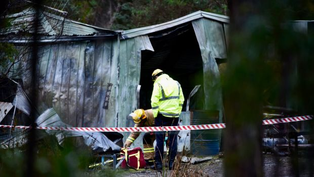 Family 'extremely distraught' after two young sisters die in Tasmania house fire